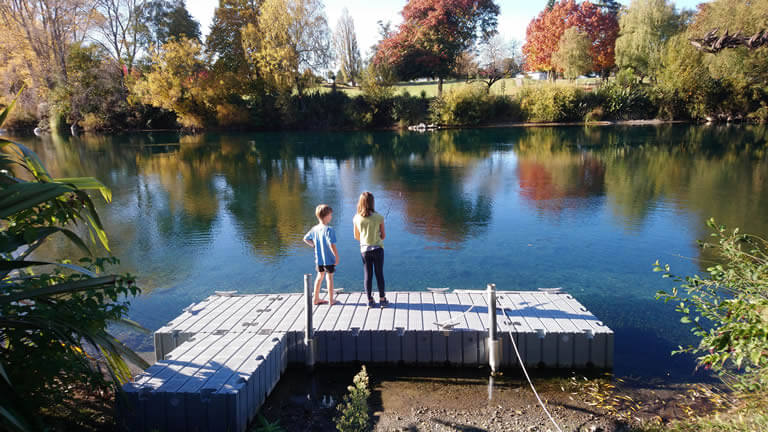 Teach a kid to fish for trout from Riverside Apartment Taupo